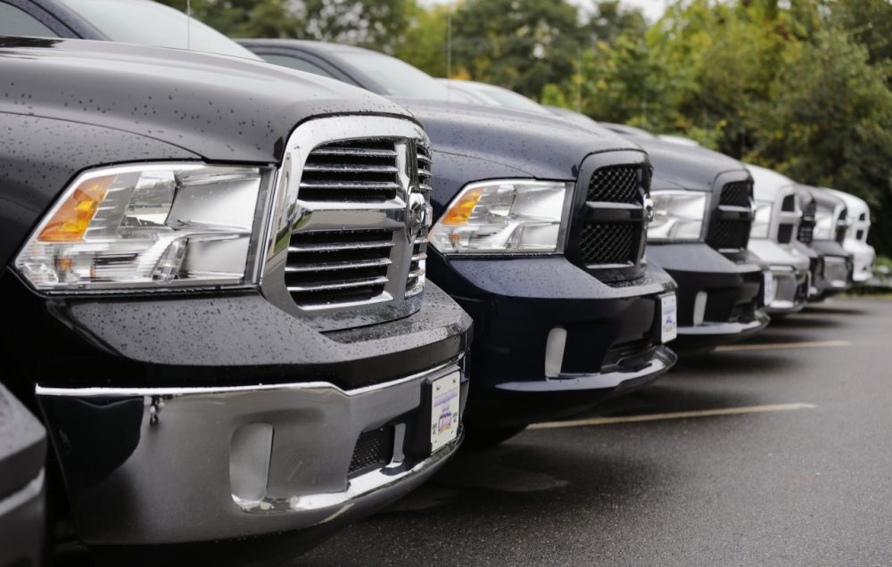 Dodge Ram pickup trucks are lined up for sale at Bill DeLuca's dealerships in Haverhill, Mass., Wednesday, Oct. 1, 2014. Chrysler Group says its U.S. sales rose 19 percent in September thanks to strong demand for the new Jeep Cherokee SUV and the Ram pickup. (Charles Krupa/AP)
