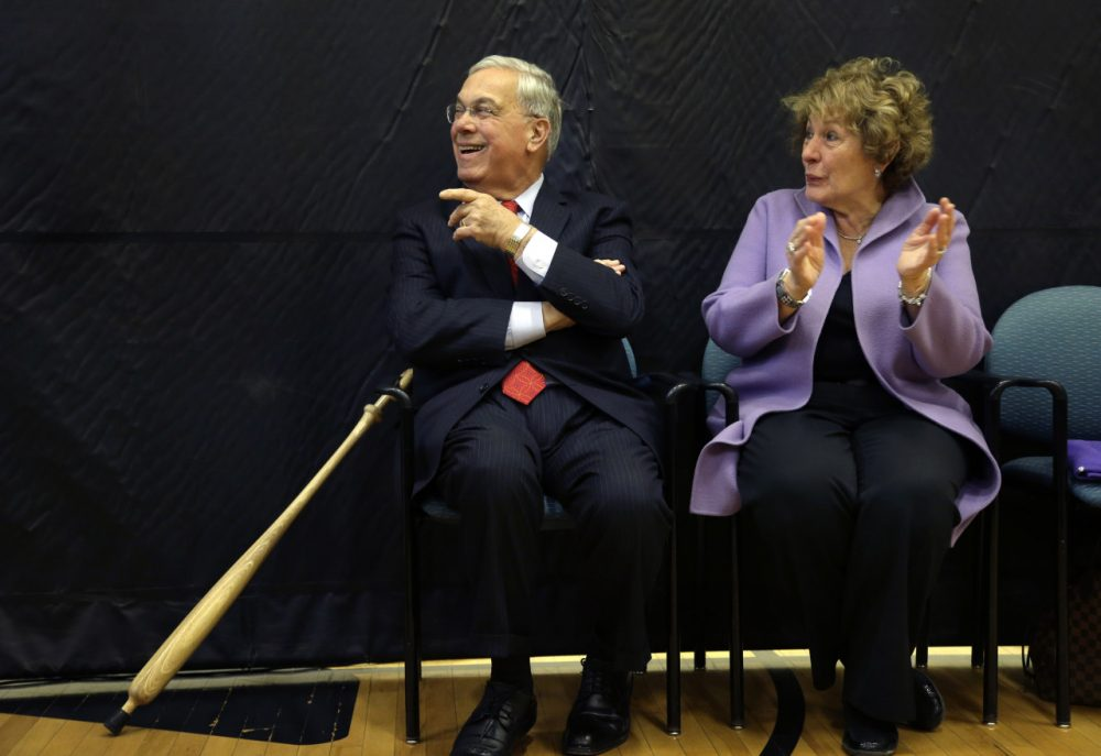 Former Boston Mayor Thomas Menino's imprint is all over Hyde Park, where he grew up and raised his family. Pictured here, Menino's wife Angela applauds as he is introduced at a 2013 ceremony held to name the Hyde Park YMCA after him. (AP)
