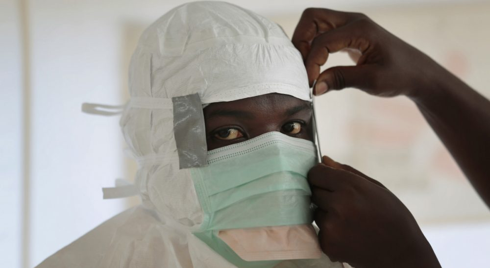 Michael Collins: The health care system that was so thoughtfully reconstructed after Liberia's long civil wars is now once again struggling to meet the demands. In this Sept. 29, 2014, file photo a MSF (Medecins Sans Frontieres) nurse gets prepared with Personal Protection Equipment before entering a high risk zone of MSF's Ebola isolation and treatment center in Monrovia, Liberia. (Jerome Delay/AP)