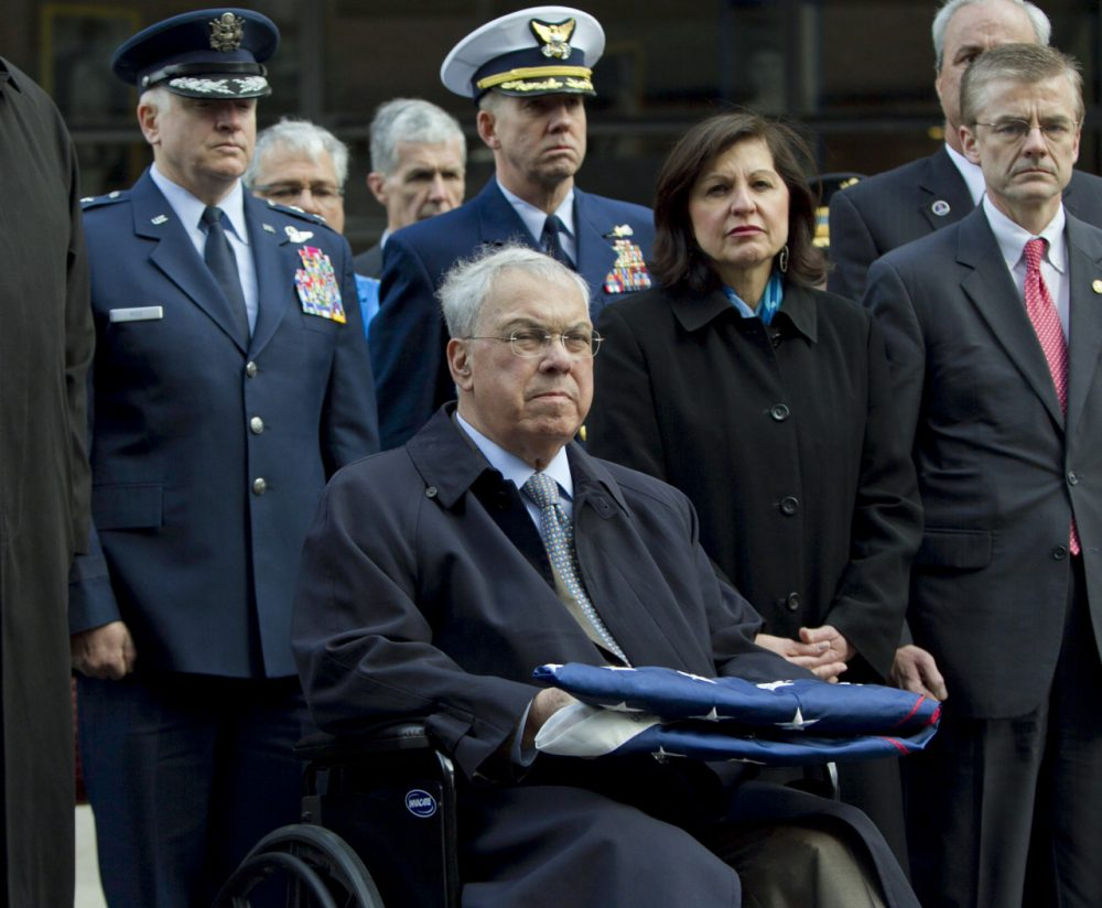 Menino. seated, recovering from a broken leg, U.S. Attorney Carmen Ortiz, second from right, and Special Agent in Charge of the FBI's Boston Field Office Richard DesLauriers, right, participate at a ceremony at the Boston Marathon blast site on Boylston Street on April 22, 2013. (Robert F. Bukaty/AP)