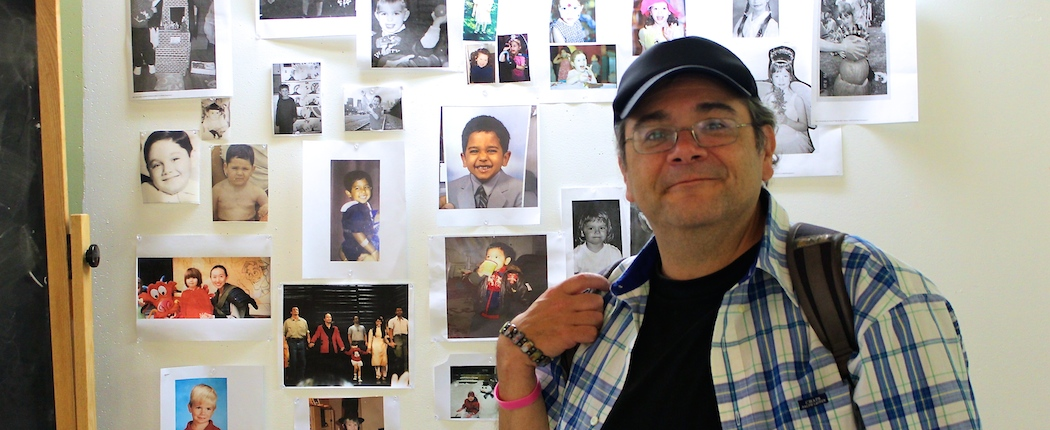 Remo Airaldi at his Harvard Extension School classroom. His kindergarten picture on the far left, second one down from top (Katherine Lam)