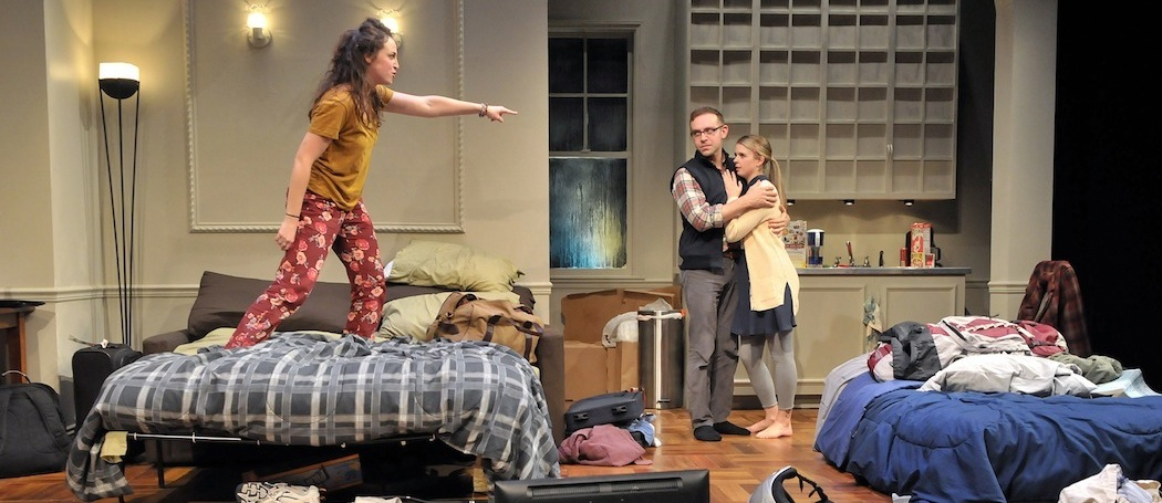 """Daphna (Alison McCartan) assails Liam (Victor Shopov) and Melody (Gillian Mariner Gordon) in """"Bad Jews"""" at SpeakEasy Stage Company. (Craig Bailey/Perspetive Photo)"""