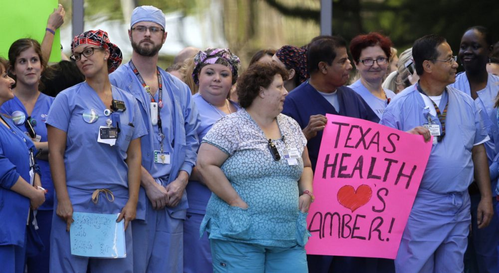"Angela Nannini: ""In times of crisis, nurses are often excluded from decision-making conversations at every level of health care organizations, from patient care decisions to hospital policy and protocols."" Pictured: Texas Health Presbyterian Hospital Dallas staff line the drive that exits the emergency room as they wait for an ambulance carrying Nina Pham to depart, Thursday, Oct. 16, 2014, in Dallas. Pham, a nurse at the hospital, was diagnosed with the Ebola virus after caring for Thomas Eric Duncan, who died of the same virus. Amber Vinson, another nurse diagnosed, was taken to a similar location in Atlanta. Both nurses have since been declared Ebola free and have been released from care. (Tony Gutierrez/AP)"