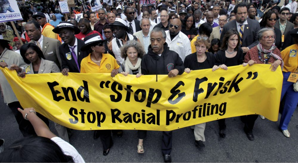 "Carol Rose: ""Police in Boston have targeted thousands of black and brown people, even when those people have done nothing wrong."" Pictured: A 2012 march against racial profiling, led by the Rev. Al Sharpton along Fifth Avenue in New York City. In 2013, the NYPD faced legal challenges over its stop, question and frisk policy. A similar legal battle could be coming to Boston given findings that the Boston Police Department has been found to use racial profiling as a basis for stops and searches. (Seth Wenig/AP)"