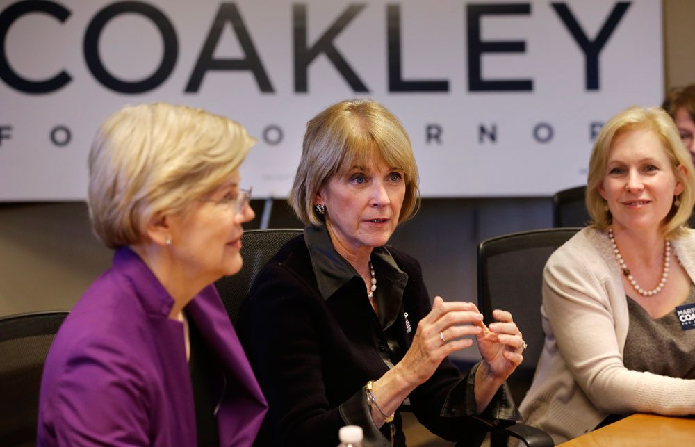 Democratic gubernatorial candidate Martha Coakley, center, speaks during a roundtable discussion as U.S. Sen. Elizabeth Warren, D-Mass., left, and U.S. Sen. Kirsten Gillibrand, D-N.Y., right, look on at offices of the Service Employees International Union on Sept. 14 in Boston. (Steven Senne/AP)
