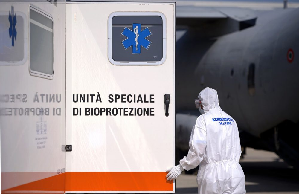 An Italian military personnel wearing a protective gets ready to take care of a pretended Ebola victim during a specialized training course for the management and transport of highly contagious patients, in Rome's Pratica di Mare military airport in Pomezia on September 24, 2014. (Filippo Monteforte/AFP/Getty Images)