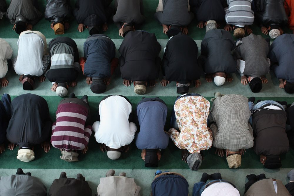 Muslim men pray after a speach by the Islamic Khalifa of the Ahmadiyya Muslim community Mirza Masroor Ahmad at Baitul Futuh Mosque in Morden on September 21, 2012 in London, England.  (Photo by Dan Kitwood/Getty Images)