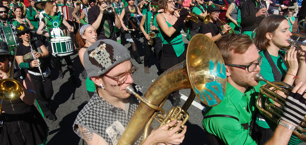 New York's Rude Mechanical Orchestra marches in the 2010 Honk Parade in Somerville. (Greg Cook)