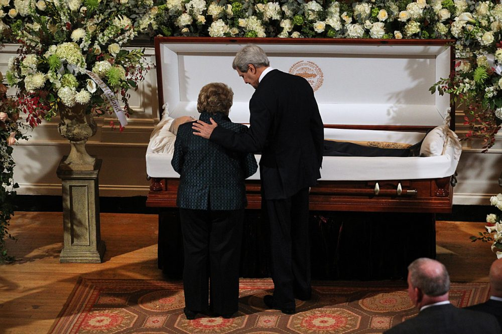U.S. Secretary of State John Kerry, right, and Angela Menino, widow of former Boston Mayor Tom Menino, stand at the casket as Menino lies in state at Faneuil Hall. (Suzanne Kreiter (AP Photo/The Boston Globe)