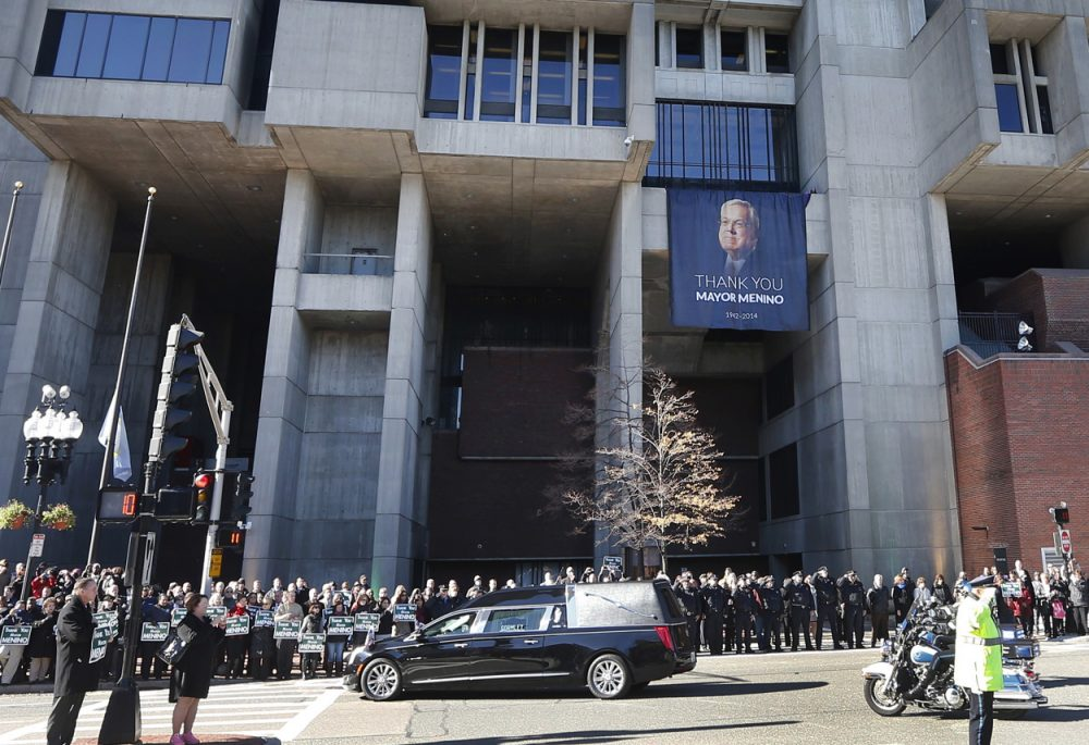 The procession passes City Hall in Boston. (Elise Amendola/AP)