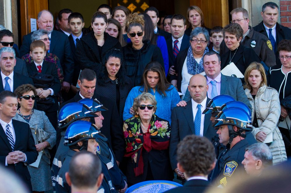 Surrounded by family, Angela Menino, Mayor Thomas Menino's wife of 48 years, stands in front of her husband's casket outside of the Most Precious Blood Parish following a funeral ceremony in her husband's honor.  (Jesse Costa/WBUR)