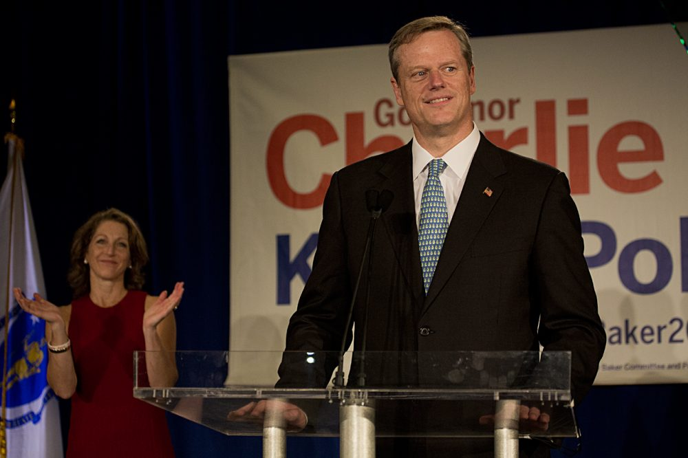 Charlie Baker, with wife Lauren, at his Election Night victory party in Boston (Jesse Costa/WBUR)