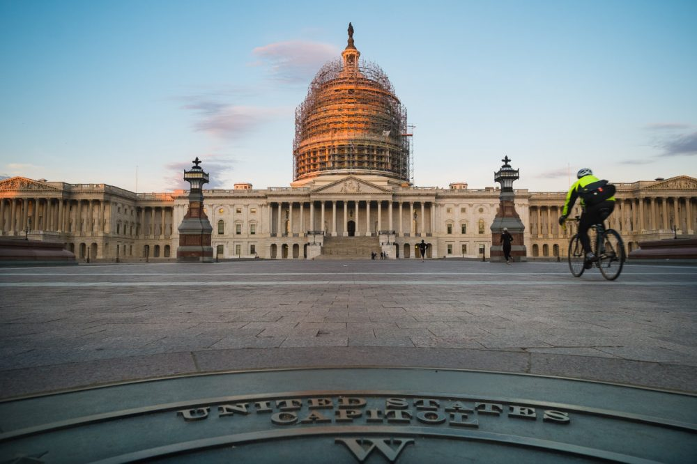 A cyclist rides across the front plaza of the U.S. Capitol on Nov. 4, 2014 in Washington.  (J. David Ake/AP)