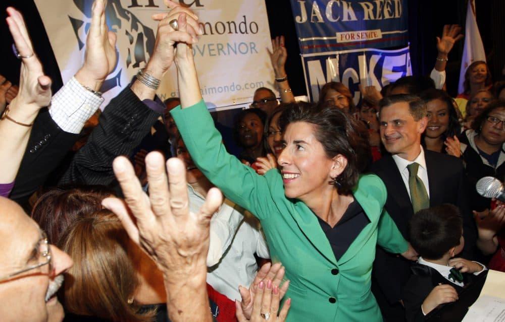 Democrat Gina Raimondo celebrates her win over Republican Allan Fung in the Rhode Island governor's race, Tuesday. (Stew Milne/AP)