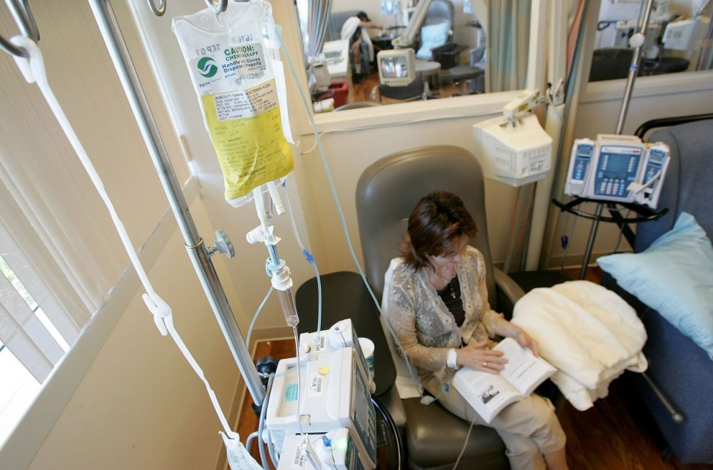 Cancer patient Terry Meyer reads a book while receiving chemotherapy treatment on June 21, 2006 in San Francisco. (Justin Sullivan/Getty Images)