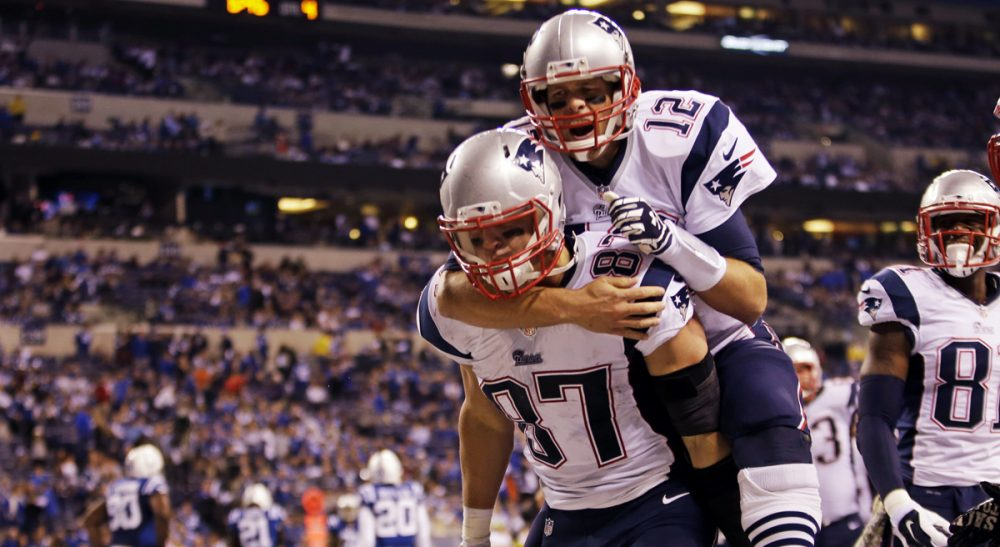Peter May: A rocky start has given way to smooth sailing for the Pats. Pictured: New England Patriots quarterback Tom Brady jumps on the back of tight end Rob Gronkowski after Gronkowski scored a touchdown against the Indianapolis Colts Sunday, Nov. 16, 2014. (AJ Mast/AP)