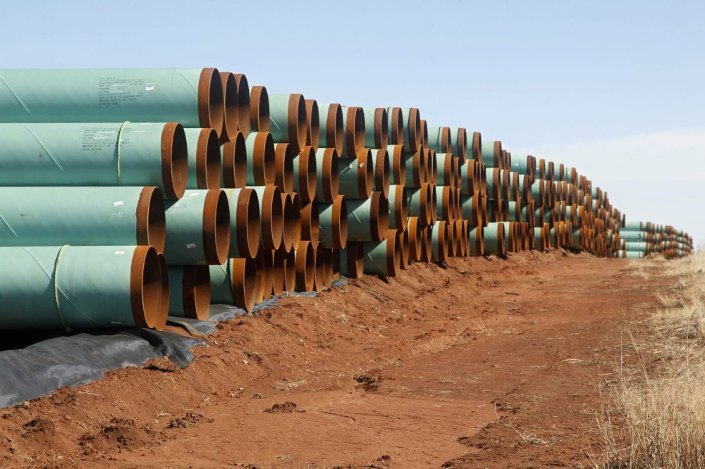 Miles of pipe ready to become part of the Keystone Pipeline are stacked in a field near Cushing, Okla. in 2012. (Sue Ogrocki/AP)