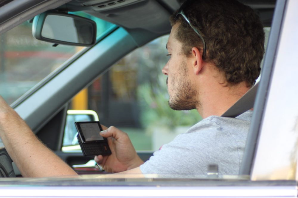 Texting and driving: Polls show most people are against it. The same polls show many people still do it. (Lord Jim/Flickr)