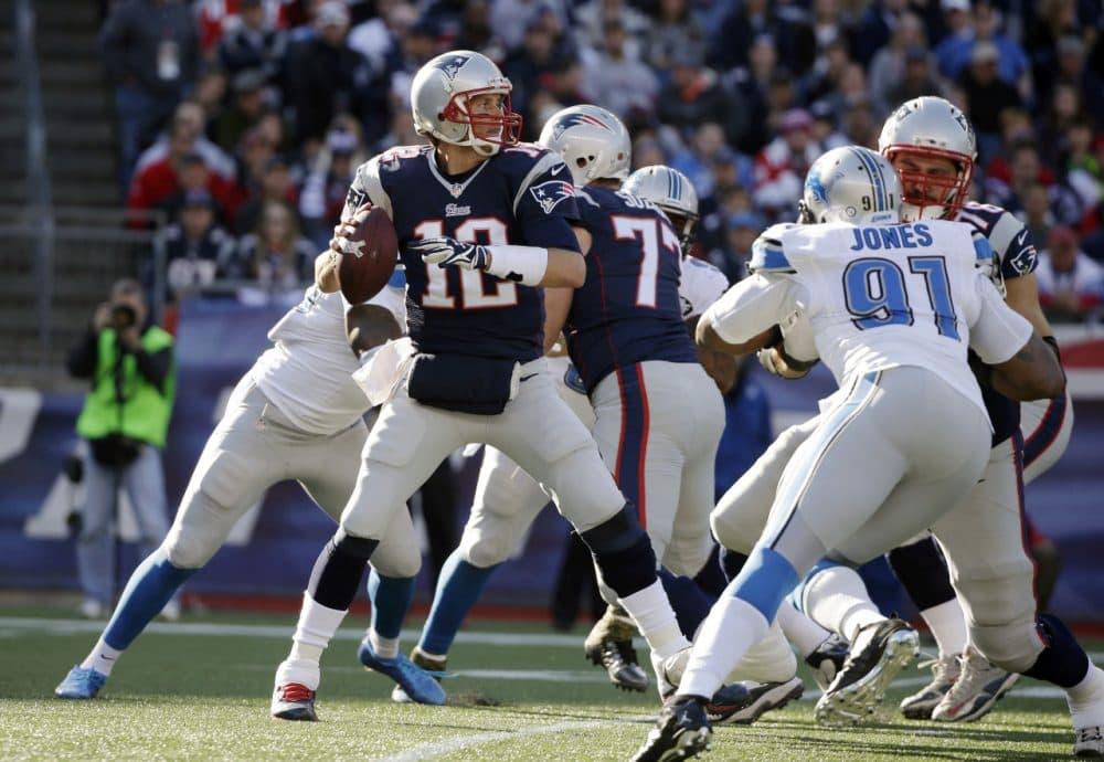 Patriots quarterback Tom Brady passes against the rush by Detroit Lions defensive end Jason Jones in the first half. (Steven Senne/AP)