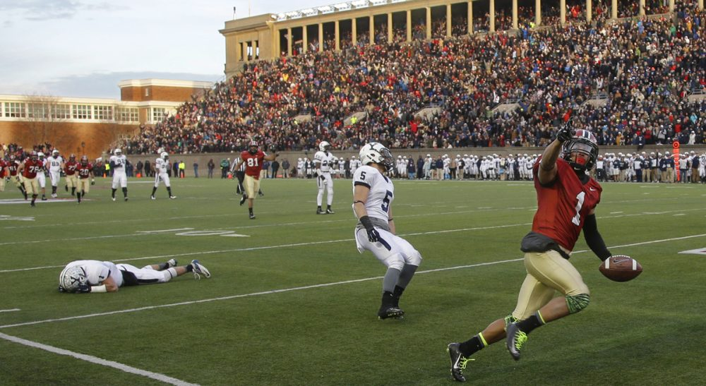 Peter May: The Ivy League allows its team to compete for NCAA titles in virtually every competitive sport – except football. In this photo, Harvard wide receiver Andrew Fischer (1) runs into the end zone for a late fourth quarter touchdown against Yale in their NCAA college football game at Harvard Stadium Saturday, Nov. 22, 2014 in Cambridge, Mass. (Stephan Savoia/AP)