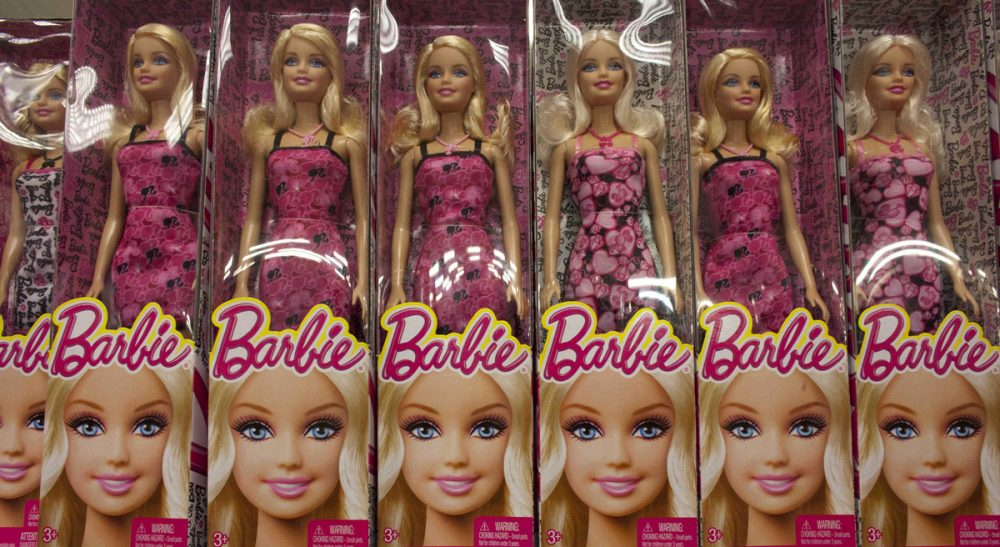 "Mattel gets it wrong -- again -- with a ""computer engineer"" Barbie who can't code and needs help from boys. To say nothing of that hot pink laptop. (Ariana Cubillos/AP)"