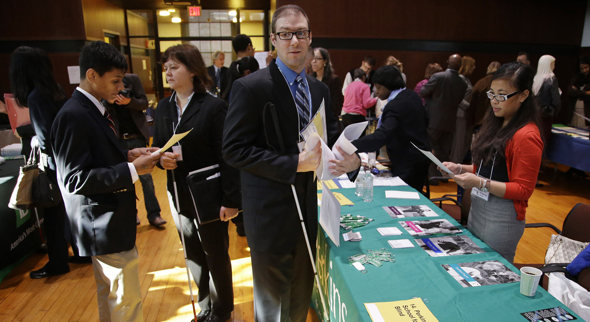 The unemployment rate for qualified blind job applicants is a staggering 75 percent. Massachusetts is in a unique position to change that. Pictured: Jeff Paquette, center, a graduate of Johnson and Wales University, waits to speak to a recruiter during a job fair for the visually impaired at the Radcliffe Institute in Cambridge, Mass., Thursday, Oct. 24, 2013. Paquette is searching for a position in the hospitality industry.(Stephan Savoia/AP)