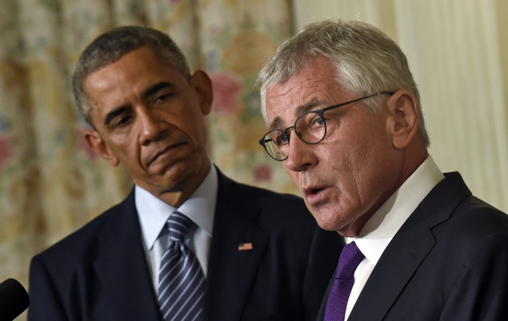 President Barack Obama, left, listens as Defense Secretary Chuck Hagel, right, talks about his resignation. (AP)