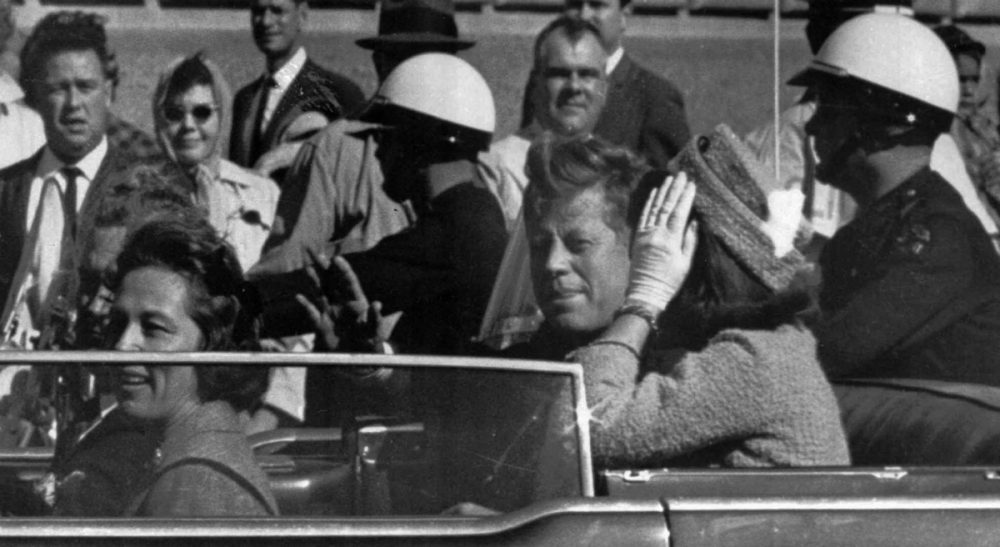 Garry Emmons: Perhaps a price we pay for the vigilance democracy requires is to tolerate the cuckoo theories to make room for those that merit further investigation. In this photo, President John F. Kennedy rides in a motorcade moments before he was shot and killed in Dallas, Tx., Nov. 22, 1963. (AP)