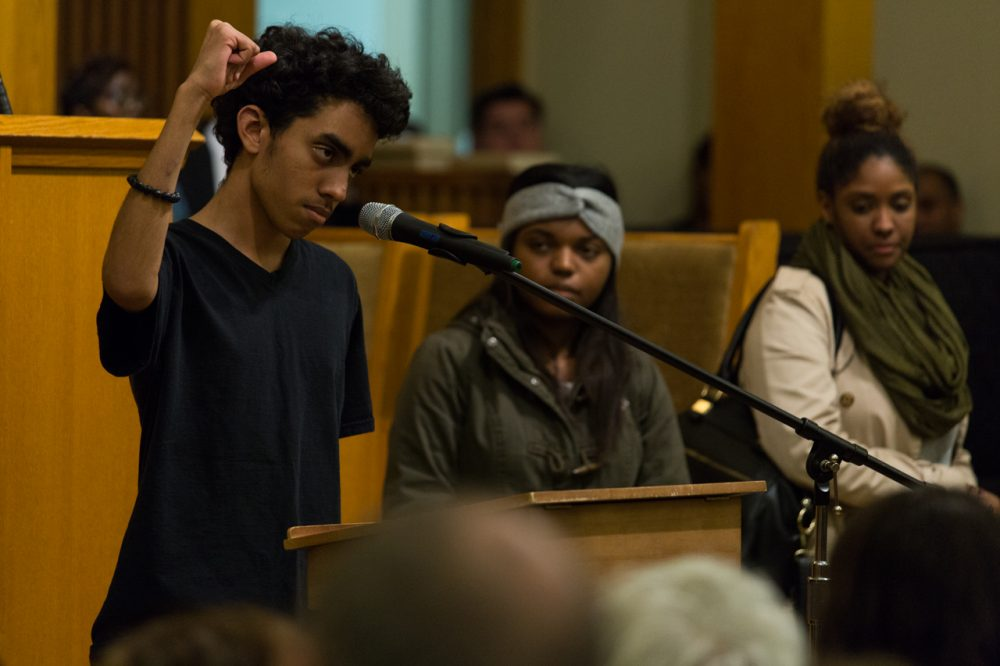 A young protester addresses delivers his thoughts on Ferguson at a packed meeting in a Roxbury church. (Joe Spurr/WBUR)