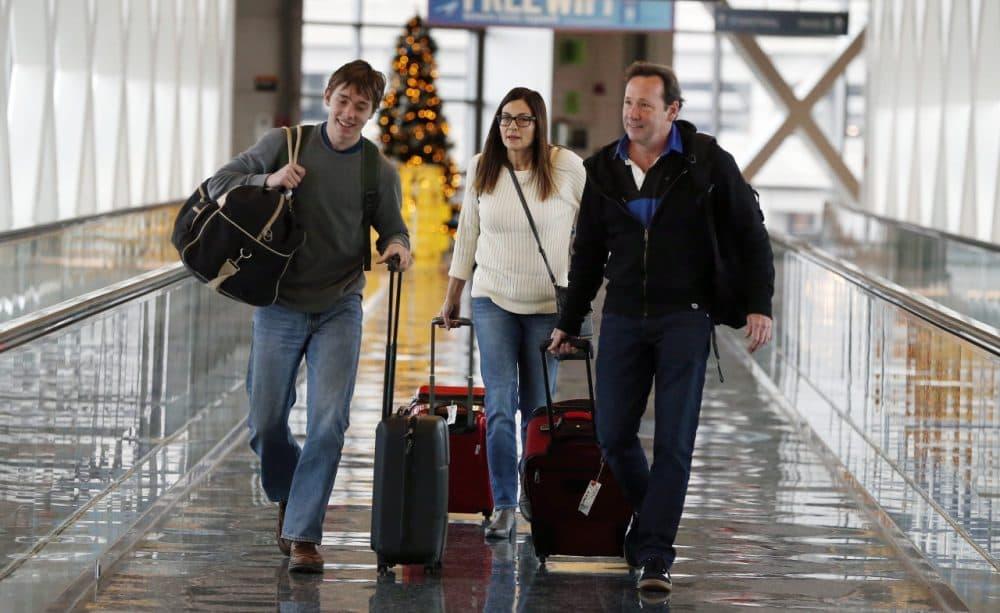 Travelers Passengers walk in a terminal at Logan International Airport in Boston on Wednesday. (Michael Dwyer/AP)