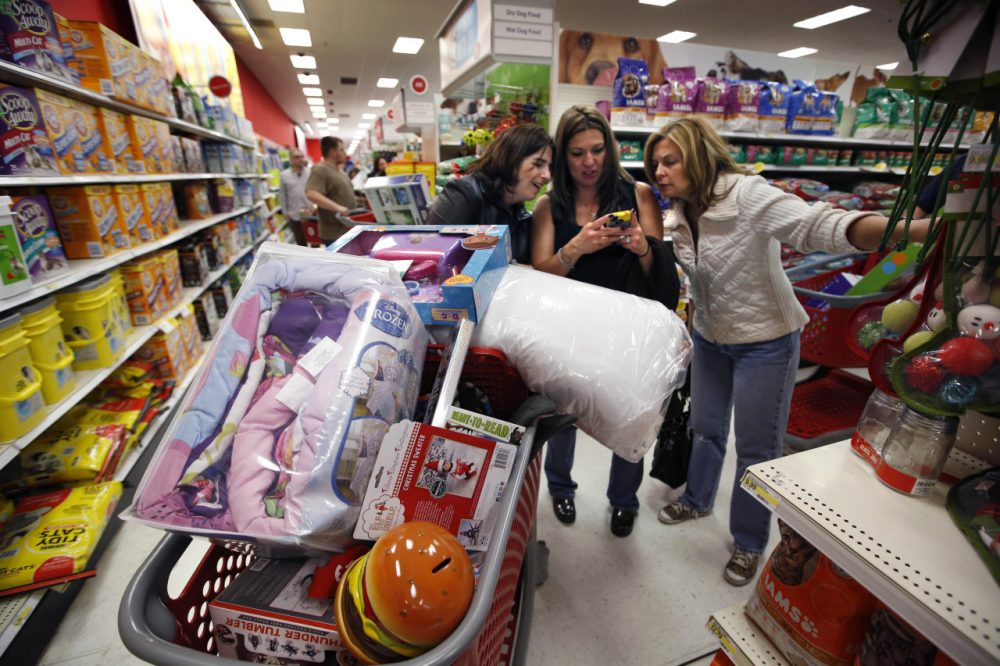 Kelly Foley, left, Debbie Winslow, center, and Ann Rich shopped Black Friday deals at Target in South Portland, Maine, on Nov. 28, 2014. (Robert F. Bukaty/AP)