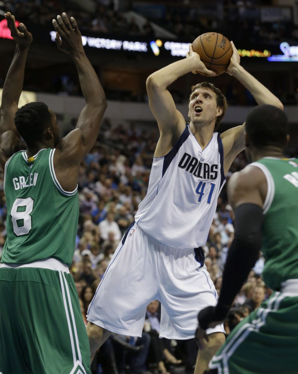 Dallas Mavericks forward Dirk Nowitzki (41) of Germany shoots against Boston Celtics forward Jeff Green (8) during Monday night's game. (LM Otero/AP)