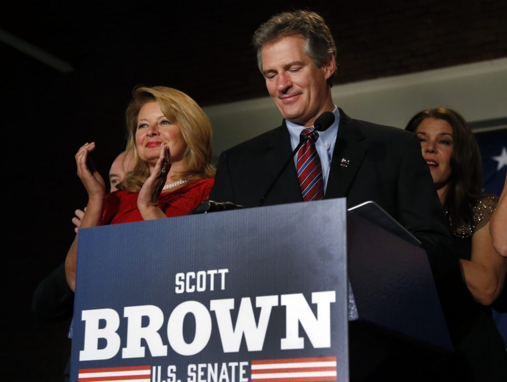 New Hampshire Republican Senate candidate Scott Brown, with his wife Gail Huff, left, concedes defeat to incumbent U.S. Sen. Jeanne Shaheen at his election night party in Manchester, N.H., on Nov. 4. (Elise Amendola/AP)