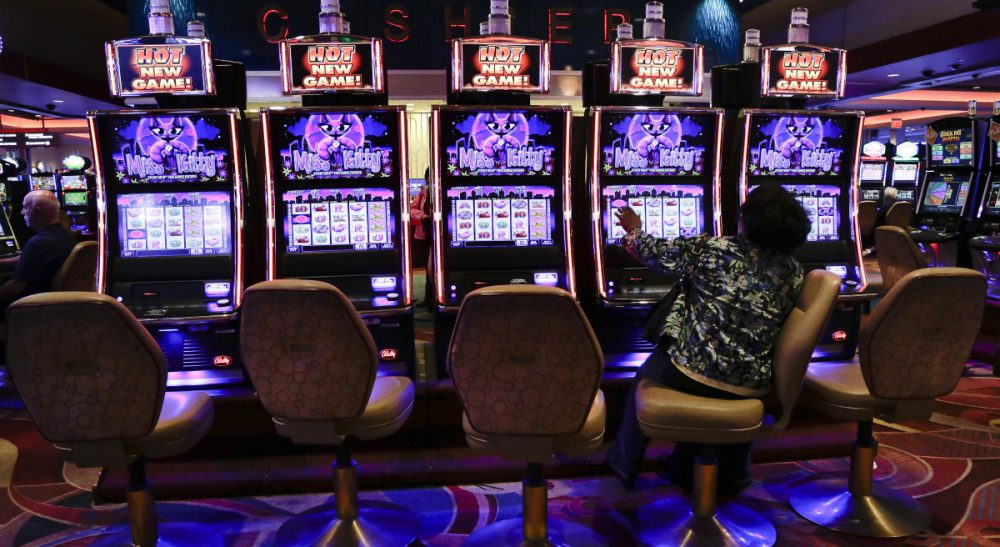 "Renée Loth: ""If the state really wants to discourage its residents from gambling away their paychecks and attract high-rolling outsiders instead, it might take a lesson from Singapore."" (Julie Jacobson/AP)"
