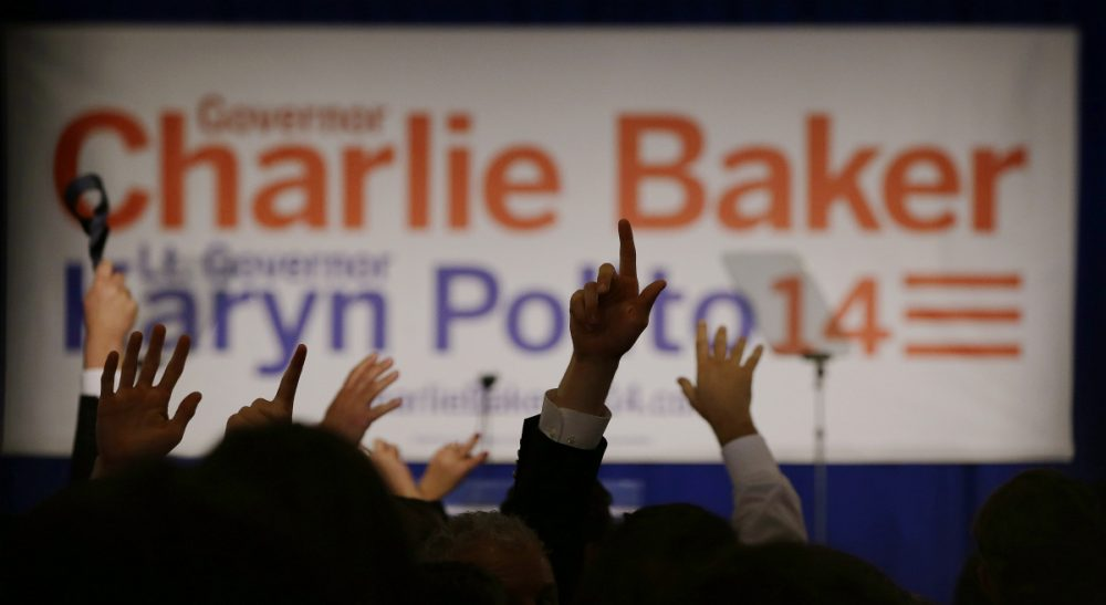 Supporters of Massachusetts Republican gubernatorial candidate Charlie Baker cheer as they watch election results come in after midnight in a race still to close to call at Baker's election night event Wednesday, Nov. 5, 2014 in Boston. (Stephan Savoia/AP)