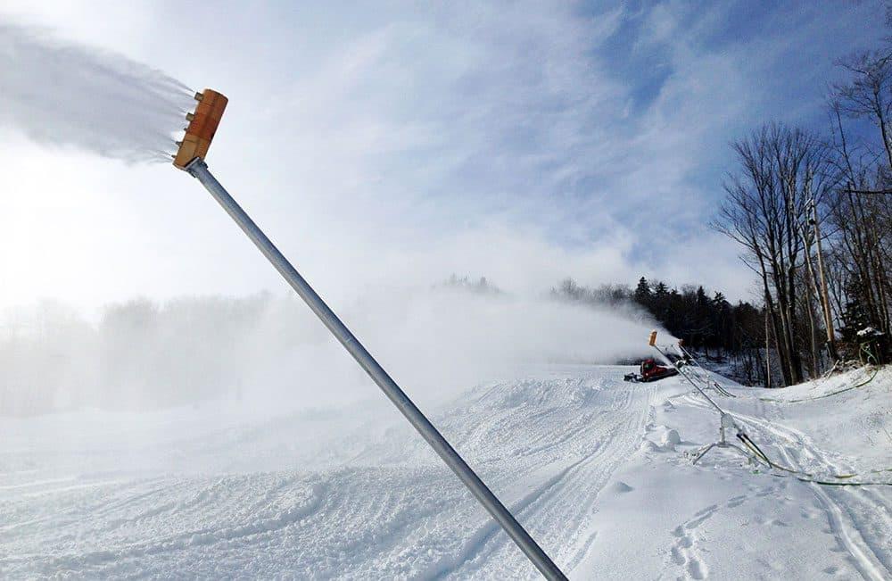 This undated image released by Mount Snow resort shows snowmakers preparing for ski season in Mount Snow, Vt. (Brendan Ryan/Mount Snow/AP)
