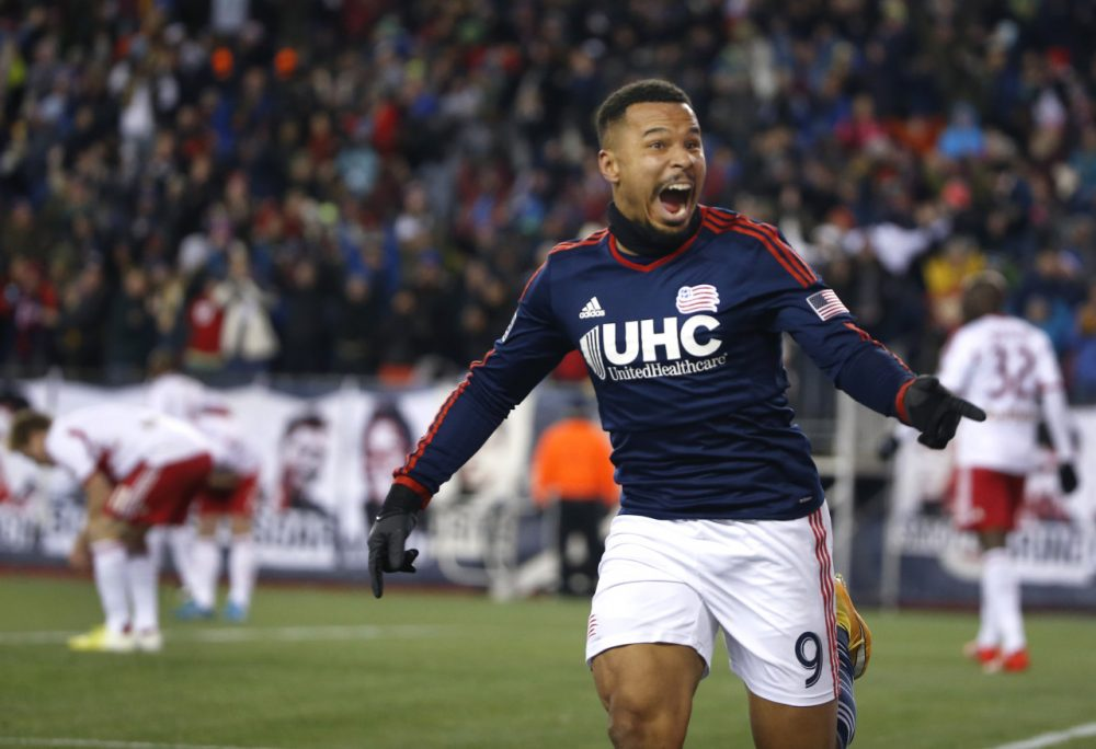 The Revolution's Charlie Davies celebrates his goal against the Red Bulls during the second half of the second soccer game of the MLS Eastern Conference final in Foxborough Saturday. The match ended 2-2 and New England advances to the MLS Cup with a two-game aggregate 4-3. (Elise Amendola/AP)