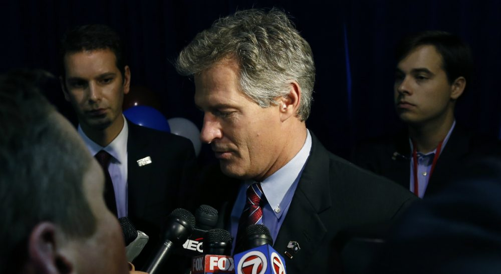 New Hampshire Republican Senate candidate Scott Brown speaks to reporters after conceding defeat to incumbent U. S. Sen. Jeanne Shaheen at his election night party in Manchester, N.H., Tuesday, Nov. 4, 2014. (Elise Amendola/AP)