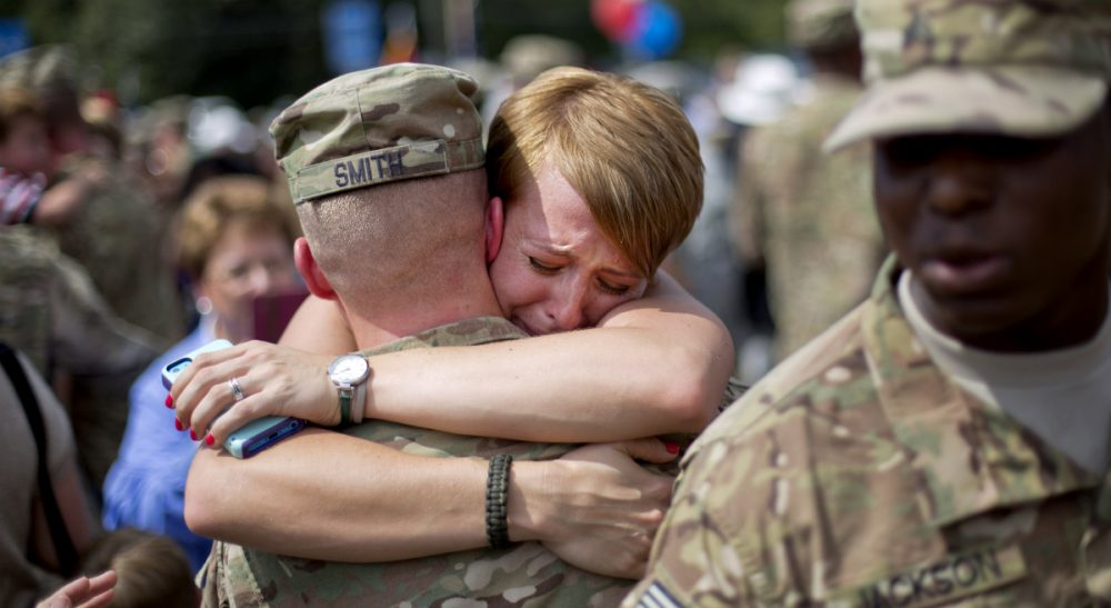 Some make the ultimate sacrifice, and others are never the same again. All of America's servicemen and women, however, endure a host of daily hardships while serving their country, and we owe them our gratitude. Pictured: Bailey Smith, right, embraces her husband Capt. Jared Smith, as he returns from a deployment to Afghanistan with the Georgia National Guard's 48th Infantry Brigade Combat Team, Tuesday, Sept. 16, 2014, in Macon, Ga. (David Goldman/AP)