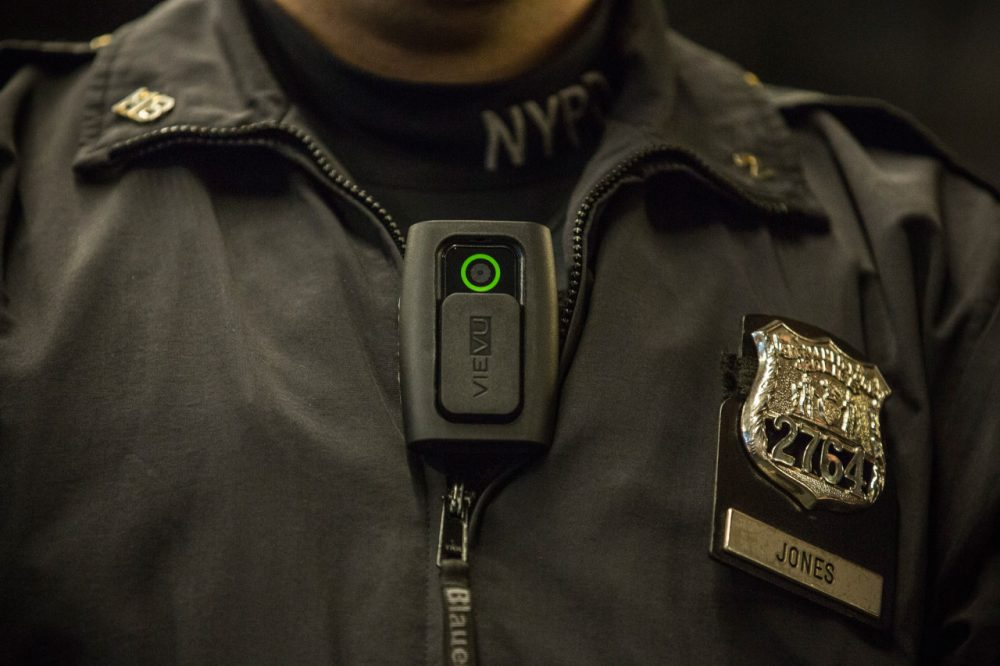 Officer Joshua Jones demonstrates how to use and operate a body camera during a press conference on December 3, 2014 in New York City. (Andrew Burton/Getty Images)