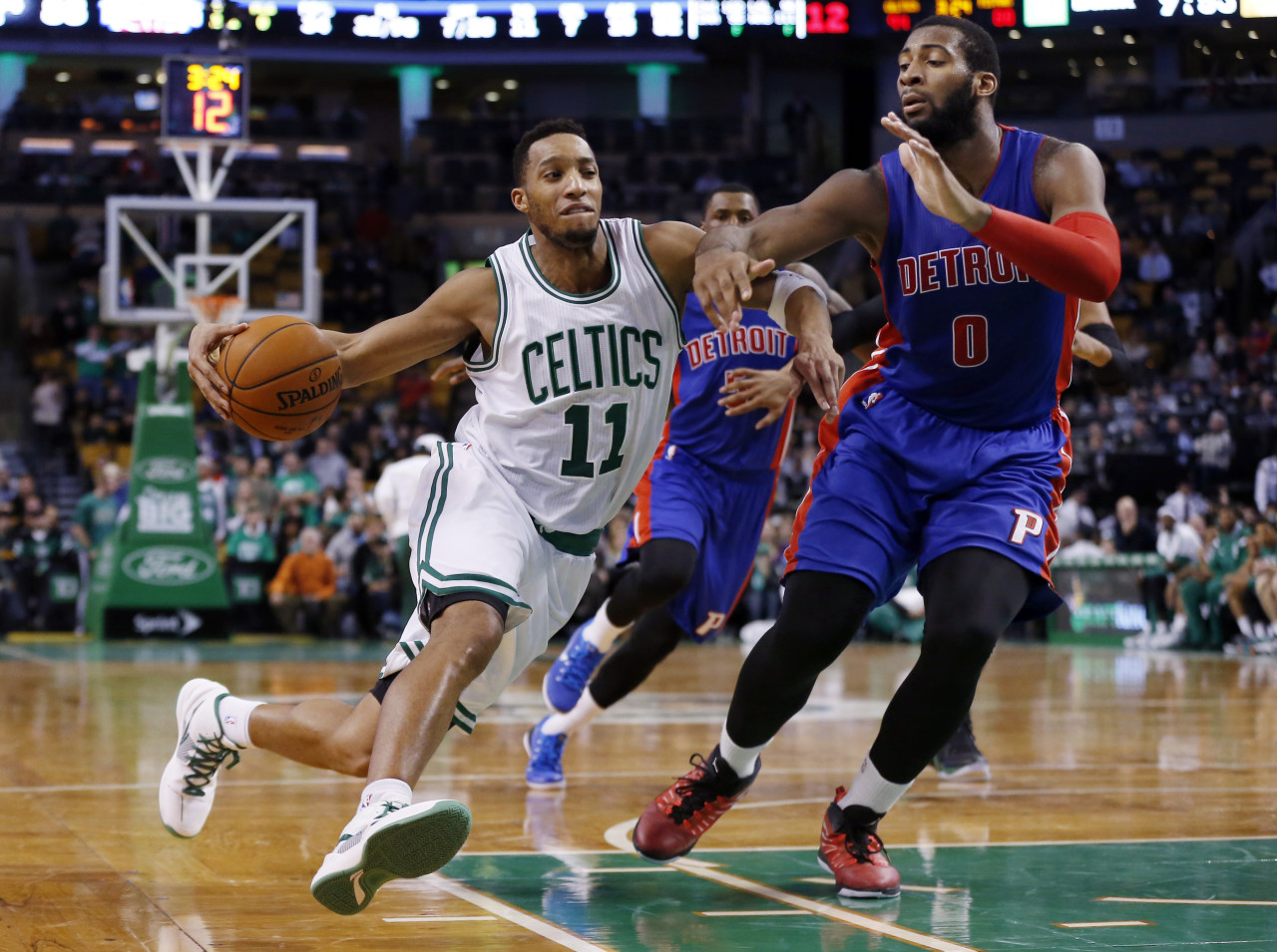 Boston Celtics guard Evan Turner (11) drives on Detroit Pistons center Andre Drummond (0) during the fourth quarter of an NBA basketball game in Boston on Wednesday. (Elise Amendola/AP)