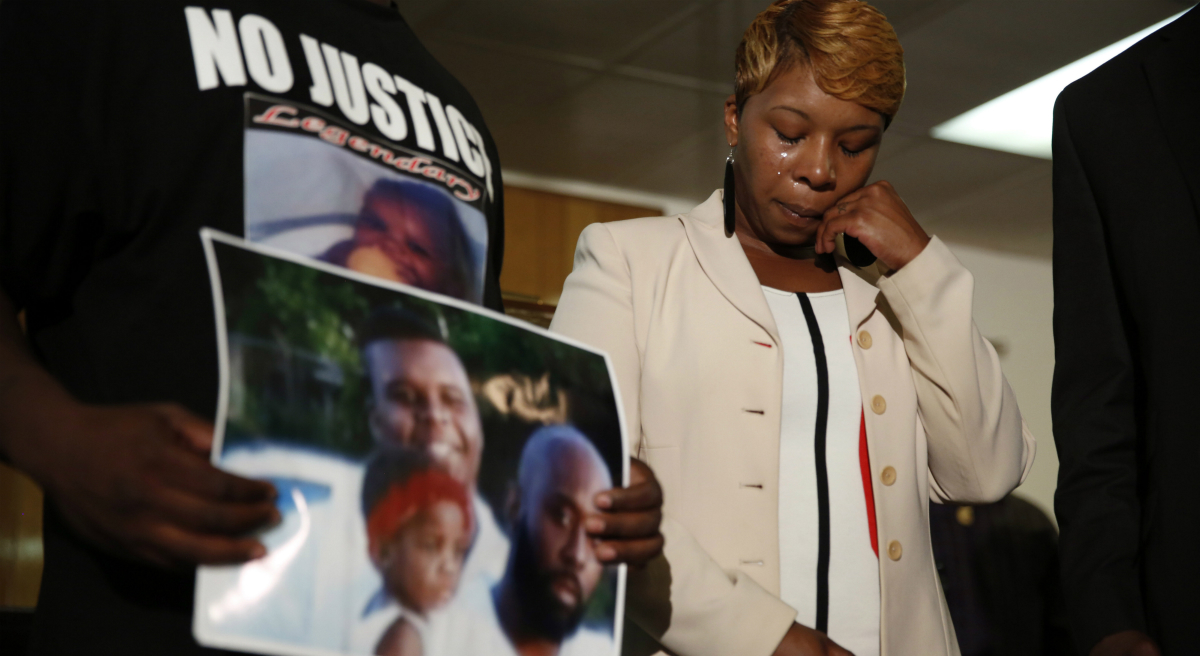 Steve Almond: It's time to convert our collective indignation and anguish into genuine moral progress. In this Aug. 11, 2014 file photo, Lesley McSpadden, the mother of 18-year-old Michael Brown, wipes away tears as Brown's father, Michael Brown Sr., holds up a family picture during a news conference in Jennings, Mo. (Jeff Roberson/AP)