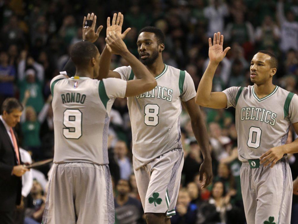 Boston Celtics guard Rajon Rondo (9) celebrates with forward Jeff Green (8) and guard Avery Bradley (0). (Steven Senne/AP)