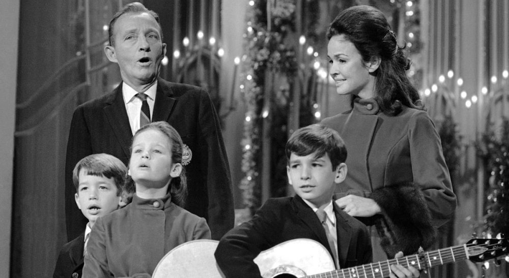 Peter May:  Here's a totally biased list of what songs should be on every loop of Christmas music on every station, streaming or on your car radio. Pictured: Bing Crosby belts out a tune, joined by his wife, Kathryn, and their three children: Nathaniel, 7; Mary Frances, 9, and Harry Lillis, 11 (left to right) in Los Angeles, Dec. 12, 1968. (David F. Smith/AP)