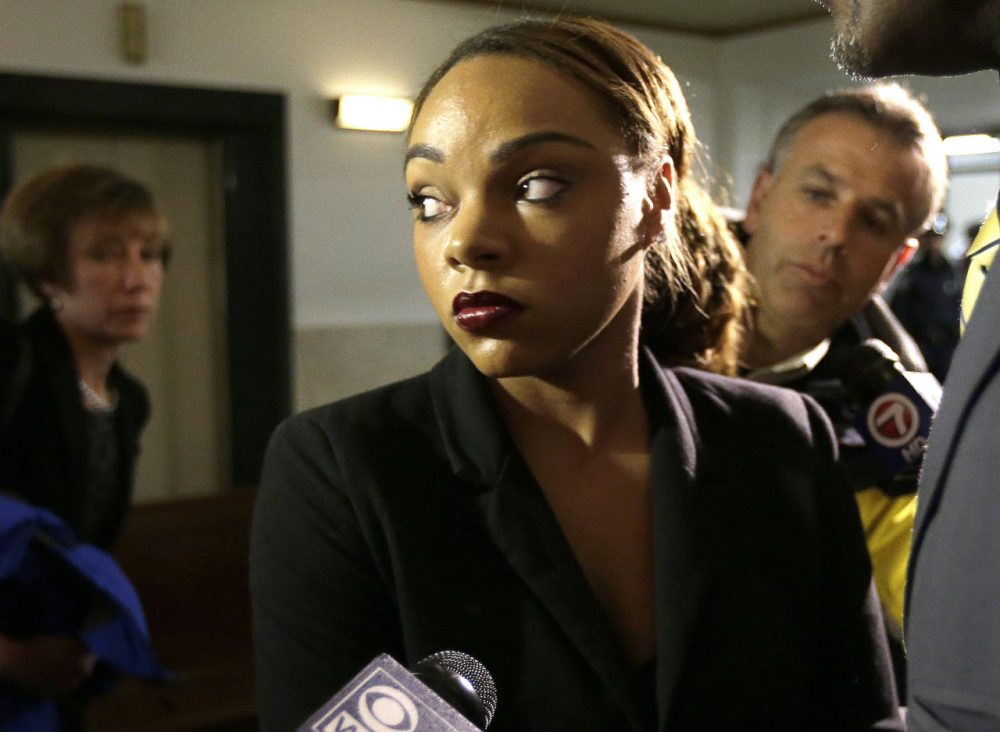 Shayanna Jenkins, fiancee of former New England Patriots tight end Aaron Hernandez, departs Suffolk Superior Court following Hernandez's arraignment on murder charges in May 2014. (Steven Senne/AP)