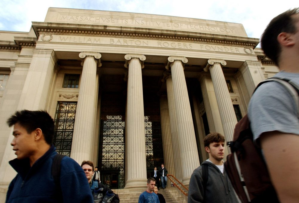 People exit a main entrance of the Massachusetts Institute of Technology, in Cambridge, Mass. (Steven Senne/AP)