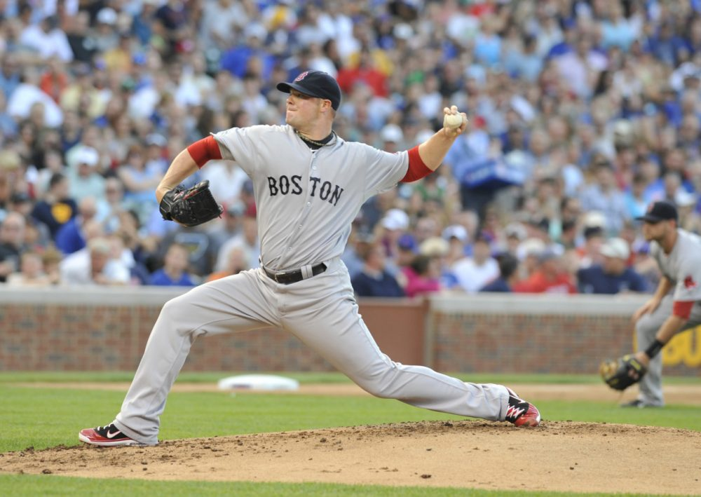Former Boston and Oakland ace Jon Lester will return to Wrigley Field in 2015 -- this time as a member of the Chicago Cubs. (David Banks/Getty Images)
