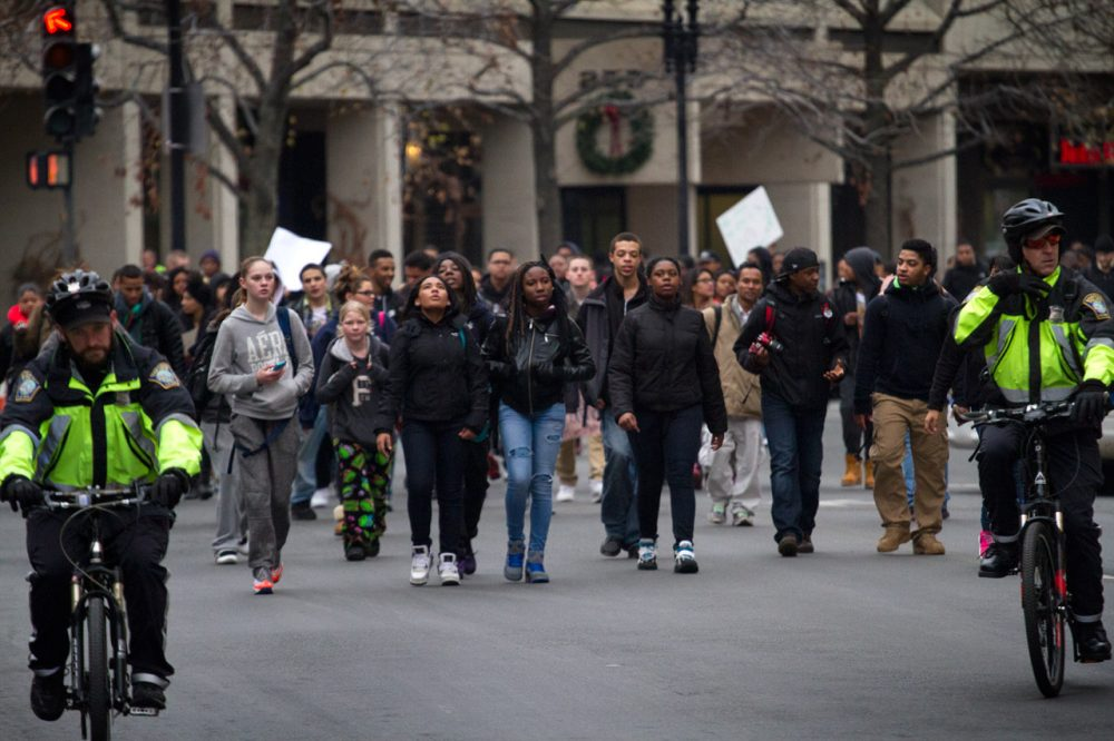 Boston students, accompanied by police, on Tuesday march in protest of recent police shootings. (Jesse Costa/WBUR)