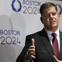 Boston Mayor Marty Walsh addresses an audience during an event held to generate public interest in a 2024 Olympics bid for the city of Boston. (Steven Senne/AP)