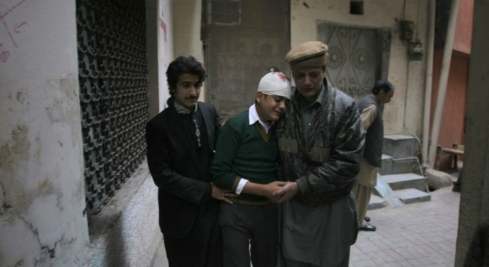 The uncle and cousin of injured student Mohammad Baqair, center, comfort him as he mourns the death of his mother, who was a teacher at the school that was attacked by Taliban, in Peshawar, Pakistan, Tuesday, Dec. 16, 2014. Taliban gunmen stormed a military-run school in the northwestern Pakistani city of Peshawar on Tuesday, killing more than 100, officials said, in the highest-profile militant attack to hit the troubled region in months. (Mohammad Sajjad/AP)